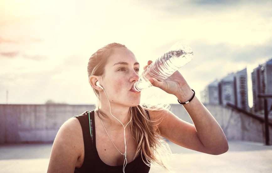Young woman exercising fitness and drinking water
