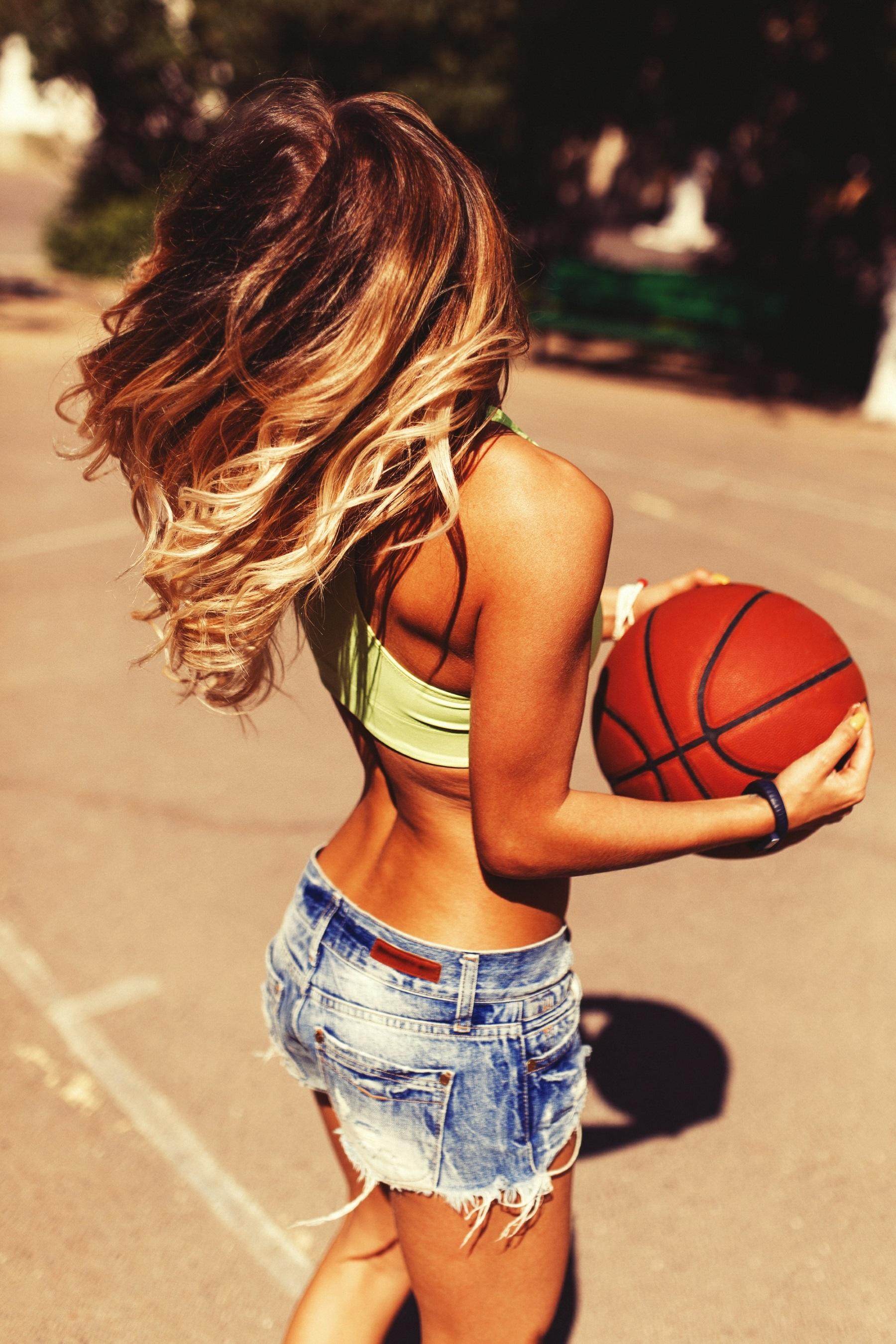 Sexy girl on the basketball court